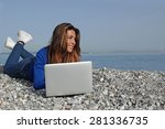 woman on beach with laptop | Shutterstock . vector #281336735