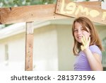 Young girl painting lemonade stand - stock photo