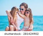mother and two happy smiling... | Shutterstock . vector #281424902