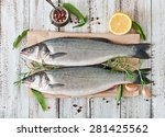 two raw seabass with spices on... | Shutterstock . vector #281425562