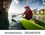 young lady paddling the kayak... | Shutterstock . vector #281469656