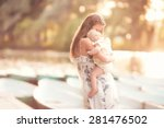 beautiful mother is standing on ... | Shutterstock . vector #281476502
