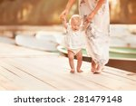 beautiful mother is walking on... | Shutterstock . vector #281479148