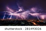 lightning storm over city in...