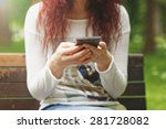 woman uses smartphone outdoors | Shutterstock . vector #281728082