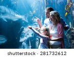 Happy Family Pointing A Fish I...