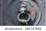 ancient door knocker on chipped ...