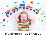 child playing with wooden train.... | Shutterstock . vector #281772686