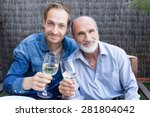 father and son in garden...   Shutterstock . vector #281804042