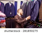 young man chooses suit | Shutterstock . vector #281850275