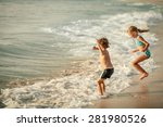 Two Happy Children  Playing On...