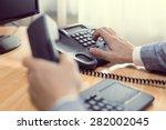 businessman dialing voip phone... | Shutterstock . vector #282002045