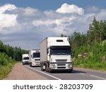 caravan of white trucks on