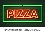 pizza neon sign on brick wall... | Shutterstock . vector #282041432