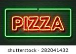 pizza neon sign on brick wall... | Shutterstock . vector #282041432