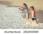 two happy children  playing on... | Shutterstock . vector #282043085