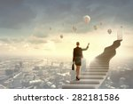 businesswoman walking up... | Shutterstock . vector #282181586