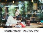 young women in coffee shop | Shutterstock . vector #282227492