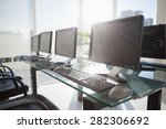 Stock photo composite image of computer in front of window in office 282306692
