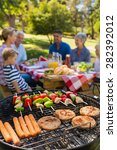family doing barbecue in the... | Shutterstock . vector #282392012