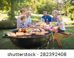 happy family having picnic in... | Shutterstock . vector #282392408