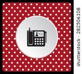 white polka dots on a red phone.... | Shutterstock .eps vector #282506108