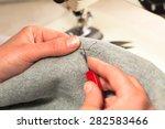 hand cut open a seam on the... | Shutterstock . vector #282583466