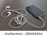 smart phone with earphone on... | Shutterstock . vector #282606566