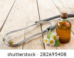 fresh herb and stethoscope on... | Shutterstock . vector #282695408