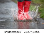 rubber boots are jumping into a ... | Shutterstock . vector #282748256