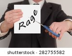 rage  man in suit cutting text