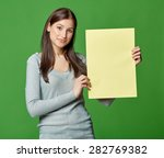 young beautiful woman  holding... | Shutterstock . vector #282769382
