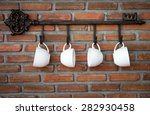 Coffee Cups Hanging On Hooks I...