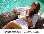 woman relaxing at the poolside...   Shutterstock . vector #282936608