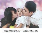Portrait Of Two Parents Kissing ...