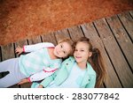 portrait of two little sister...   Shutterstock . vector #283077842