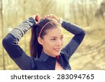 woman tying hair in ponytail... | Shutterstock . vector #283094765