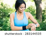 smiling sporty woman in... | Shutterstock . vector #283144535