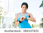 happy sporty woman using smart... | Shutterstock . vector #283147652