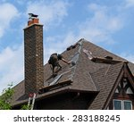 roofer at work repairing a...   Shutterstock . vector #283188245