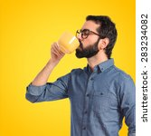young hipster man drinking... | Shutterstock . vector #283234082