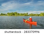 Male Paddler Paddling A Red...