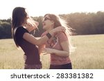 two young girls having fun at...   Shutterstock . vector #283381382