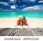 Couple On A Tropical Beach At...