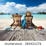 couple on a tropical beach at... | Shutterstock . vector #283421276