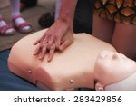 woman doing cpr on a mannequin... | Shutterstock . vector #283429856
