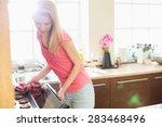mid adult woman baking cookies... | Shutterstock . vector #283468496