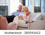 mature couple at home relaxing... | Shutterstock . vector #283541612