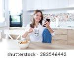 young beautiful woman using... | Shutterstock . vector #283546442