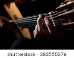 man playing acoustic guitar | Shutterstock . vector #283550276
